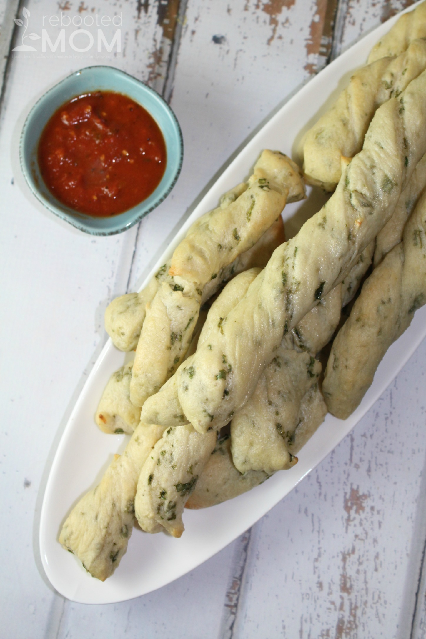 These Kale Garlic Breadsticks are a wonderful way to use up fresh kale and perfect to pair with chilly fall soups! #bread #kale