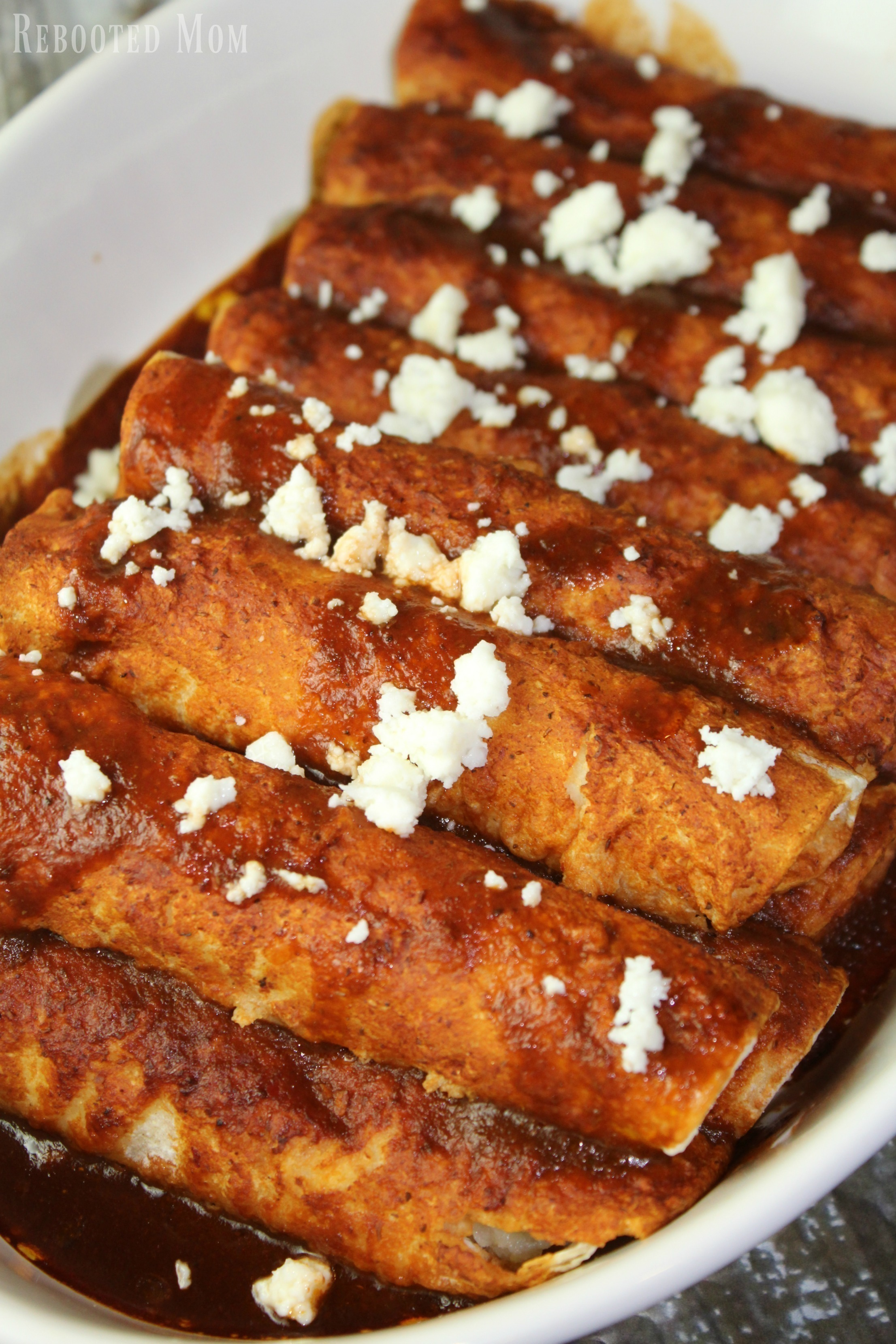 A delicious blend of guajillo chiles, onion, and spices in a thick, red sauce used as a base for these filling potato enchiladas.