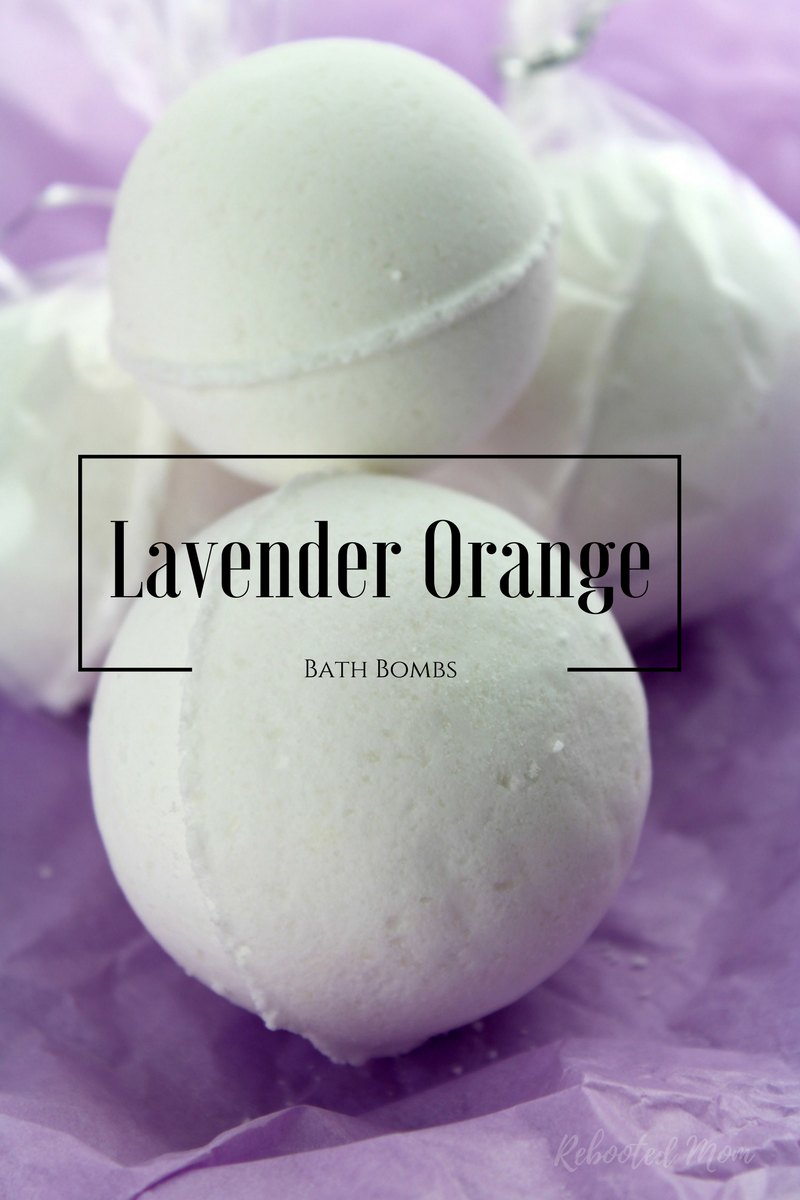 These Lavender Orange Bath Bombs smell like popsicles and are easy to make at home with a few, simple ingredients! Learn how to make your own Lavender Orange Bath Bombs with this easy DIY!