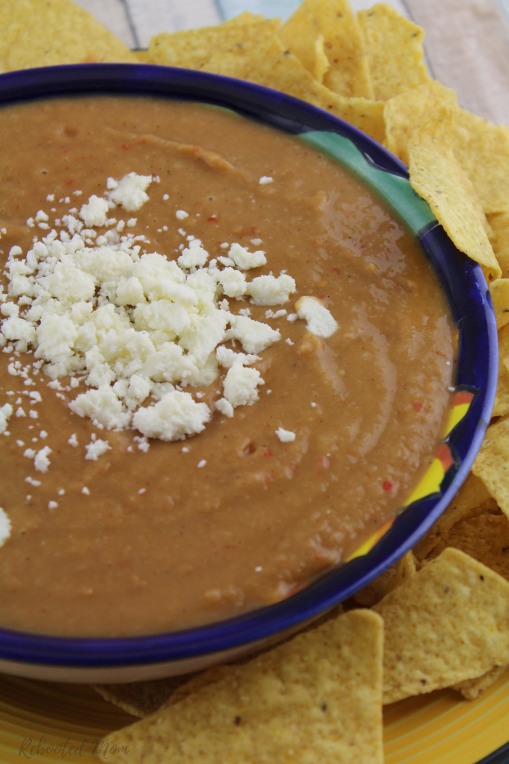Combine a few simple ingredients together for this incredibly easy Mexican bean dip with lots of kick - serve with chips at your next get together or make for the kids to snack on.