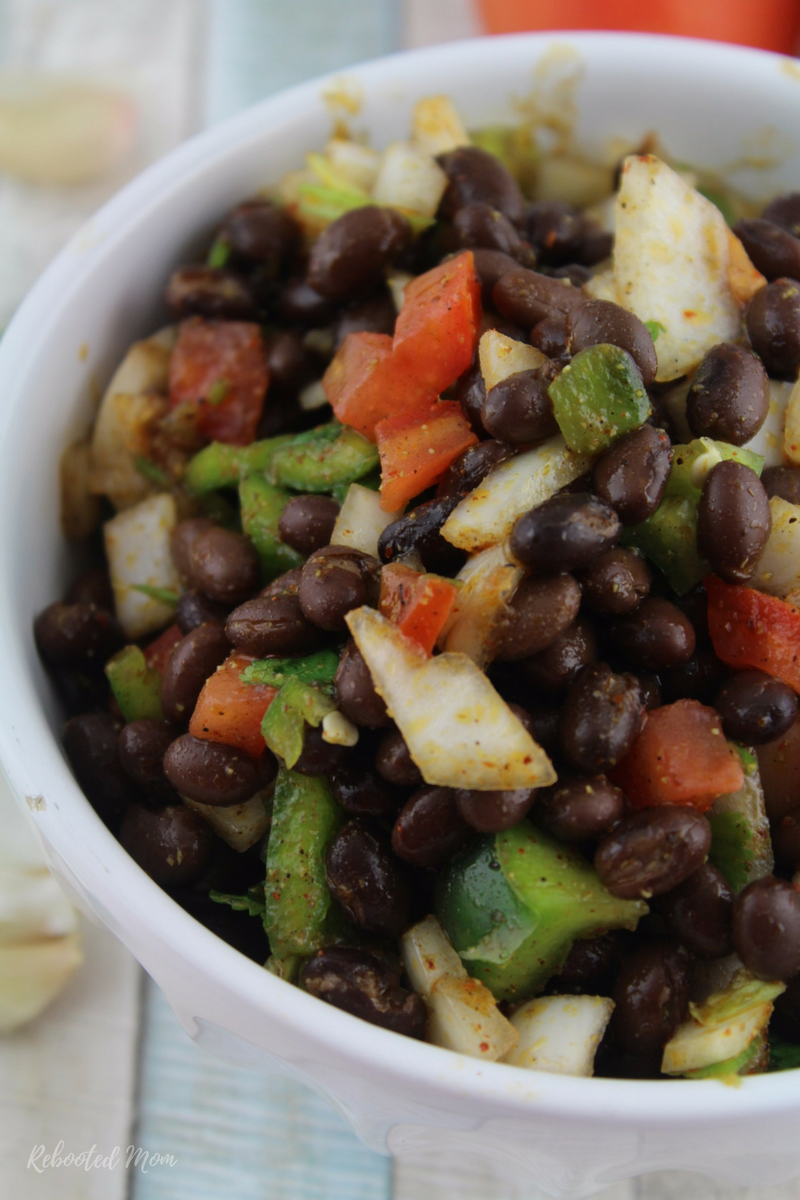 A delicious combination of black beans, vegetables, and Mexican spices that is incredibly easy to make and perfect for a barbecue or potluck.
