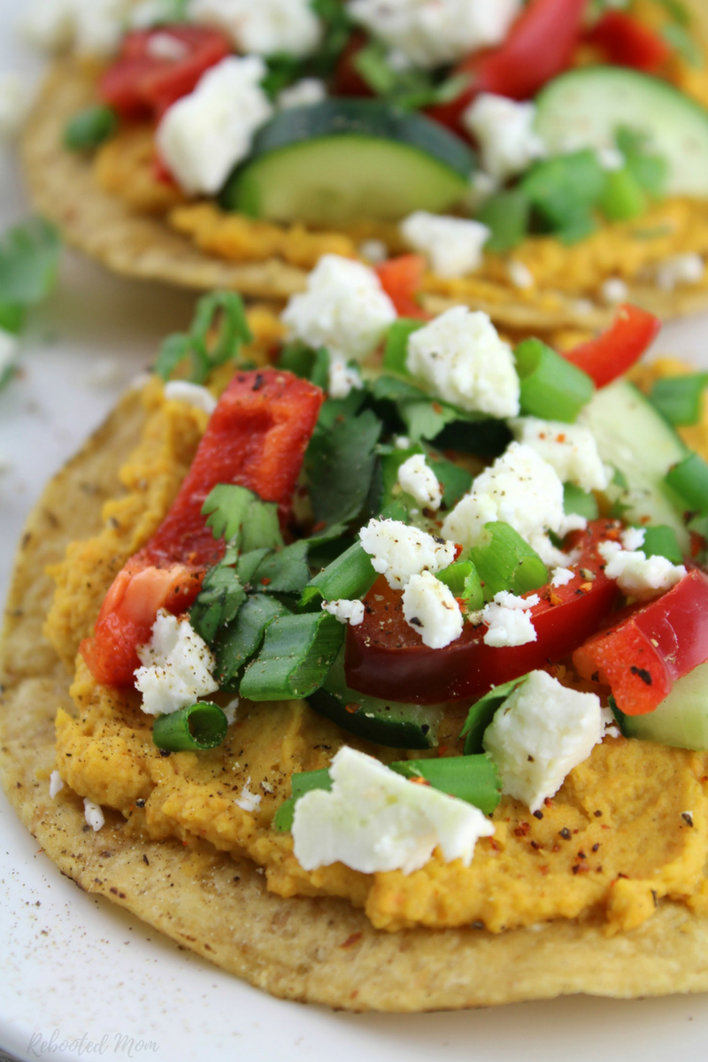 Go meatless with these healthy sweet potato and vegetable tostadas topped with chile lime seasoning.