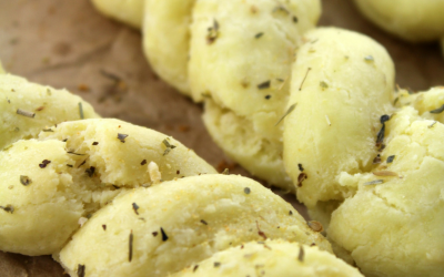 Combine almond flour, tapioca flour, eggs and coconut oil to make a grain-free, gluten-free Paleo garlic breadstick that will satisfy your next urge for carbs.