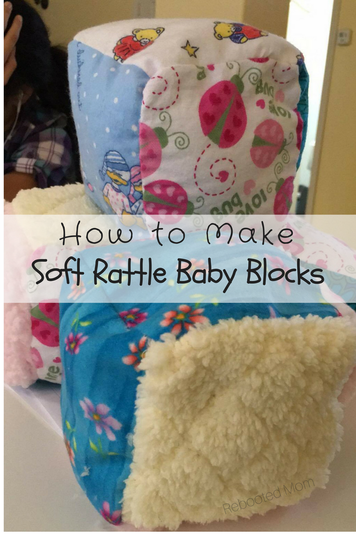 These soft rattle baby blocks are a great way to use fabric scraps and are super easy to sew, even for a beginner! #baby #sewing