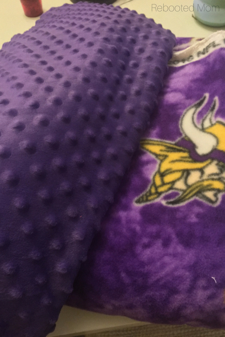 This easy sew NFL cuddle blanket is the perfect handmade gift for a true football fan, and can be sewed in less than one hour!