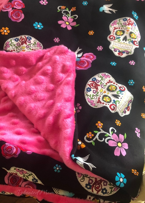 Día de Muertos is a Mexican holiday celebrated throughout Mexico. Learn how to sew a Dia de Muertos cuddle blanket to honor the holiday and keep warm!