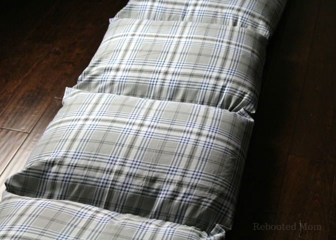 Learn how to make a pillow bed (or pillow cushion) for kids using pillows and twin flat sheet along with this simple tutorial.