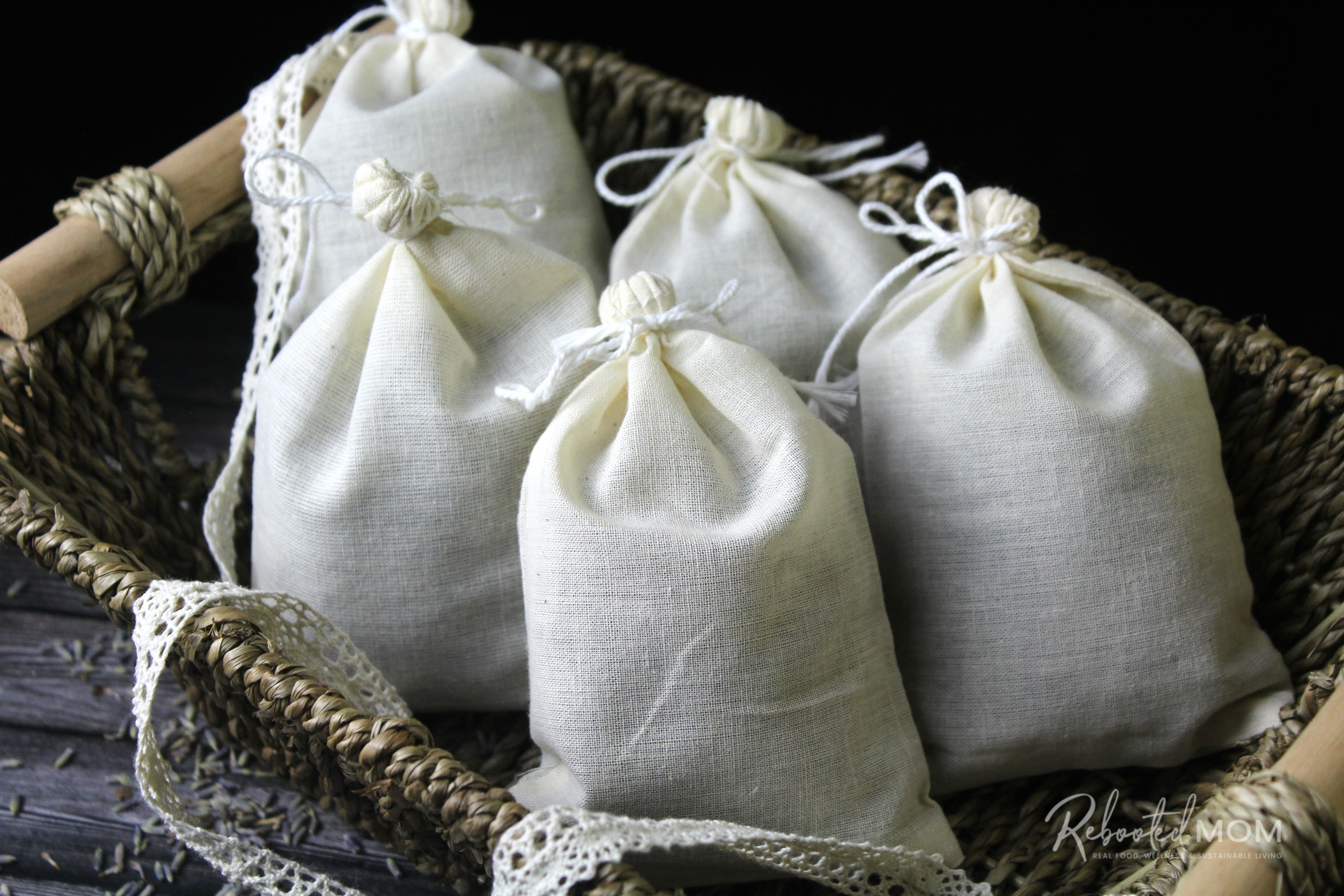 Unlabeled muslin bags filled with herbs, sitting in a basket. \\ These herbal dryer sachets are a beautiful and healthy way to scent your laundry and they make wonderful gifts for friends, co-workers and even teachers!