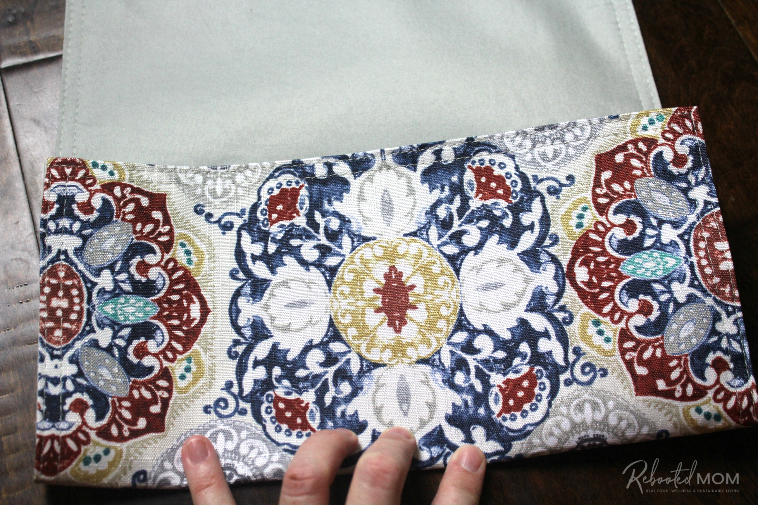 Step 2 - placemat clutch purse  \\ This placemat clutch purse comes together in under ten minutes for just a few dollars. It makes a stylish purse or case for baby wipes and a few diapers!