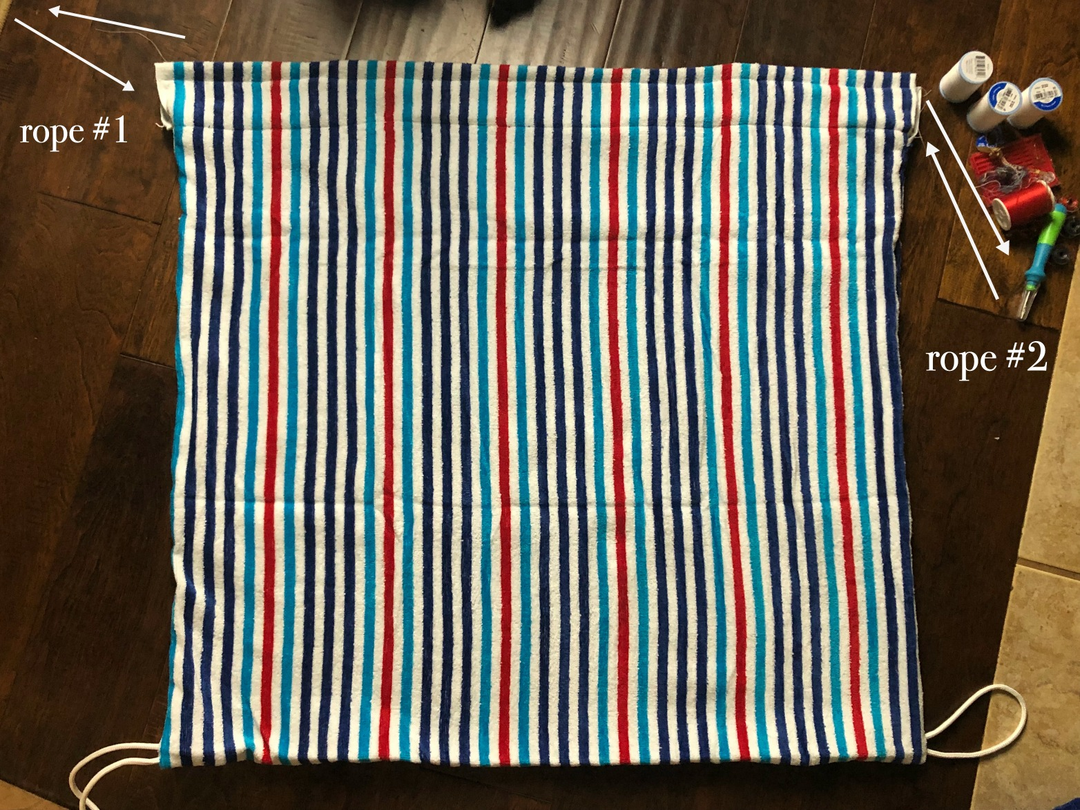 DIY Beach Towel Bag - feed the rope through the pockets