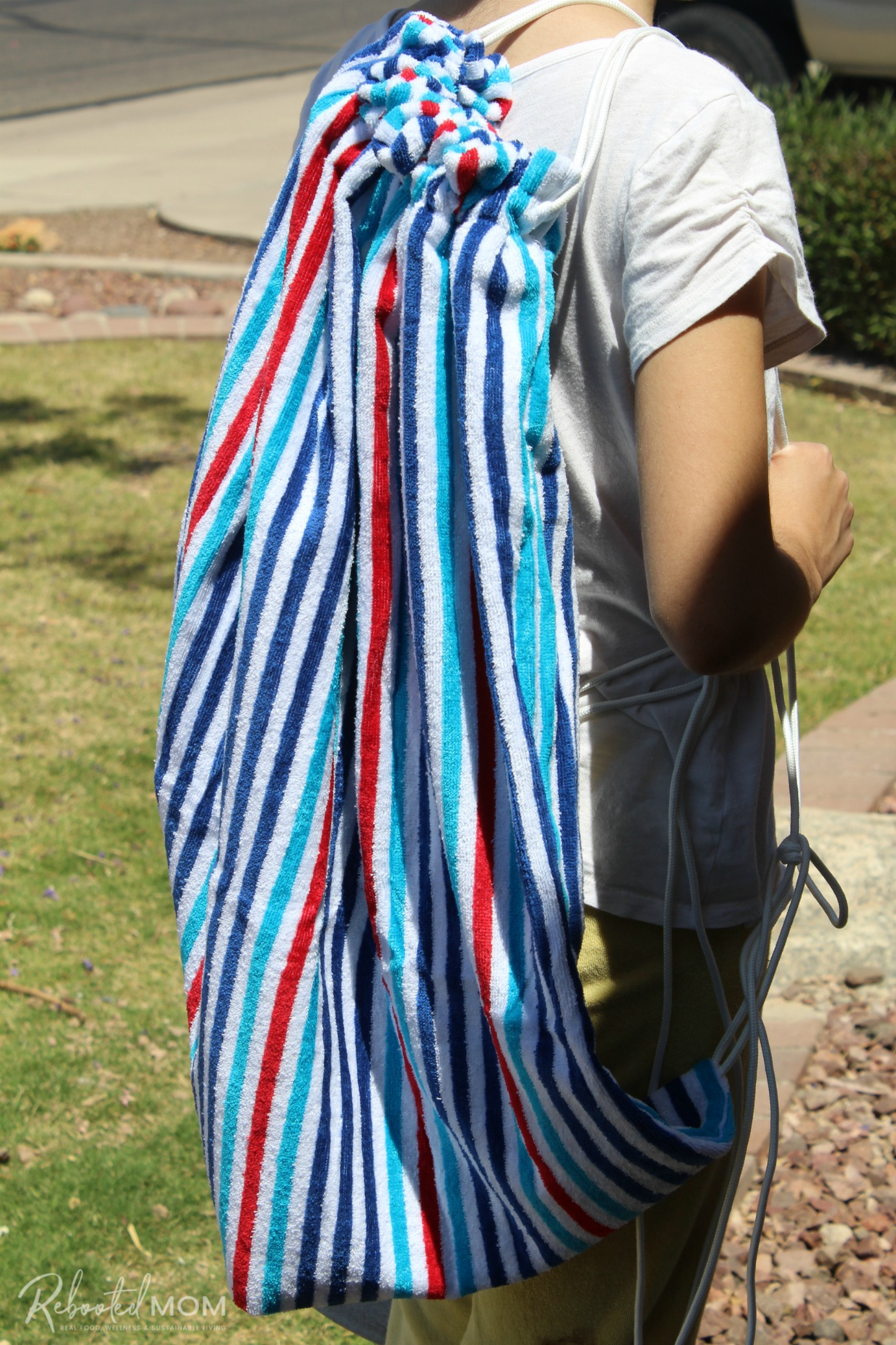 DIY Beach Towel Bag worn over one shoulder
