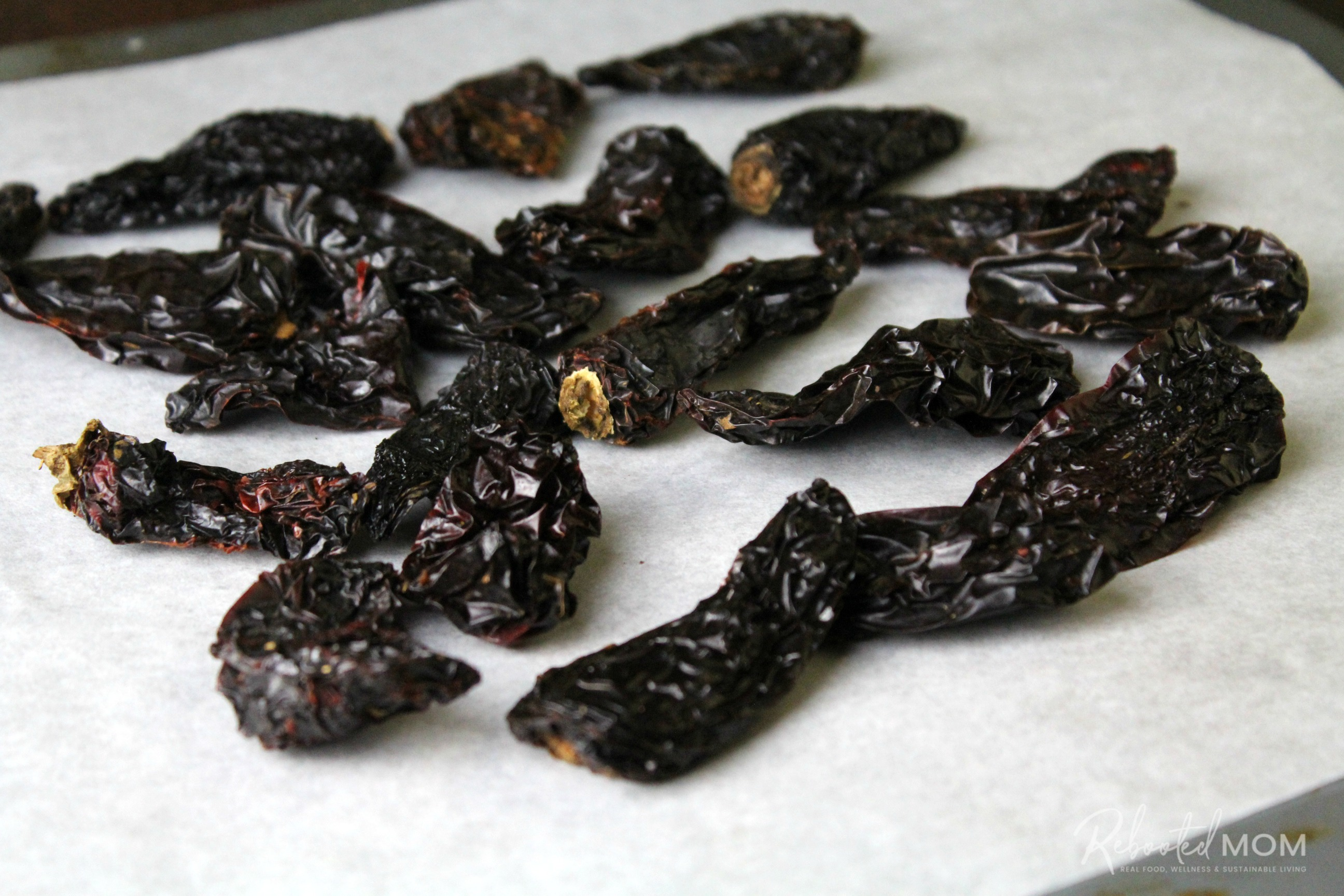 Morita chiles on a baking sheet before roasting