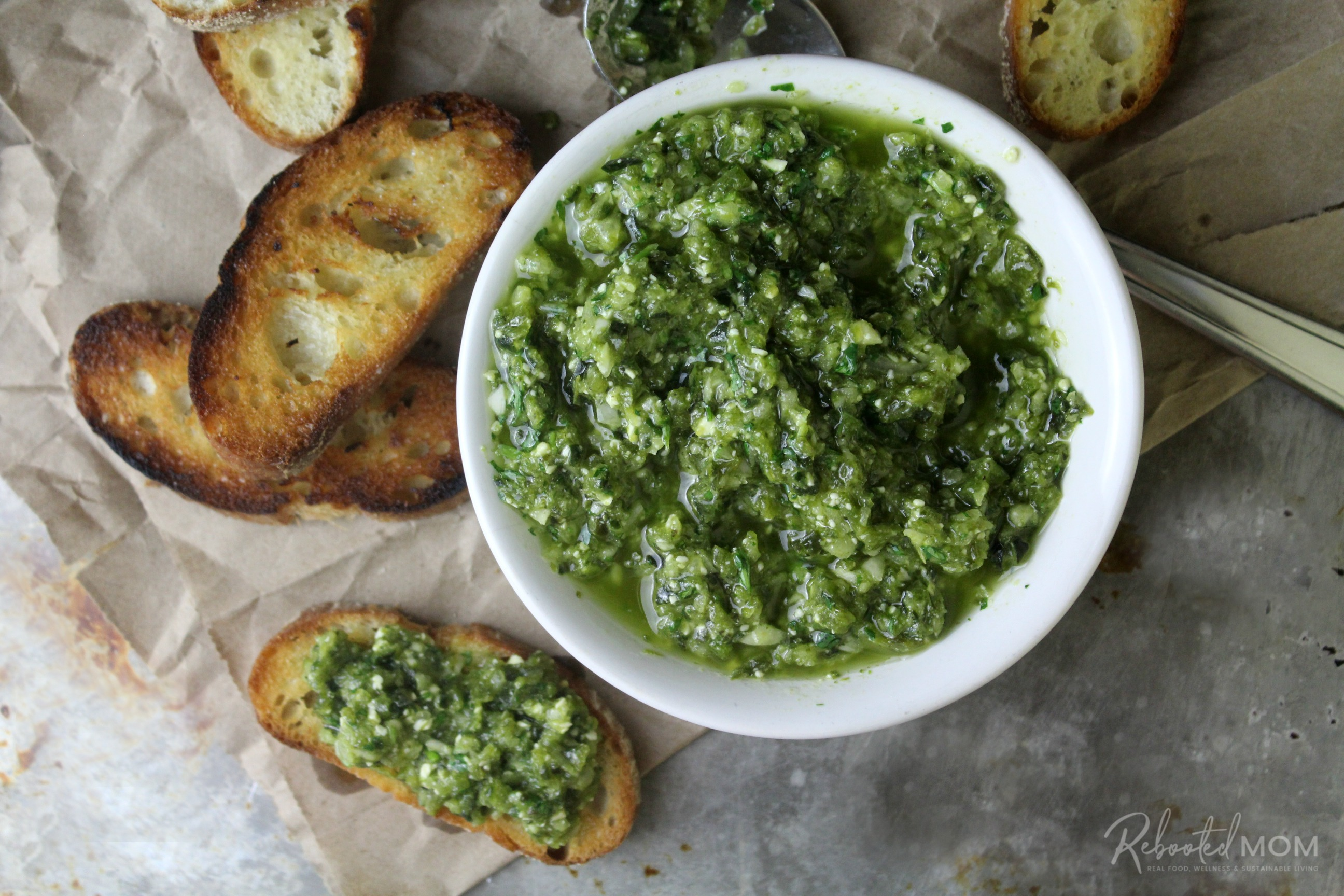 Roasted Poblano and Garlic Pesto spread on a toasted baguette