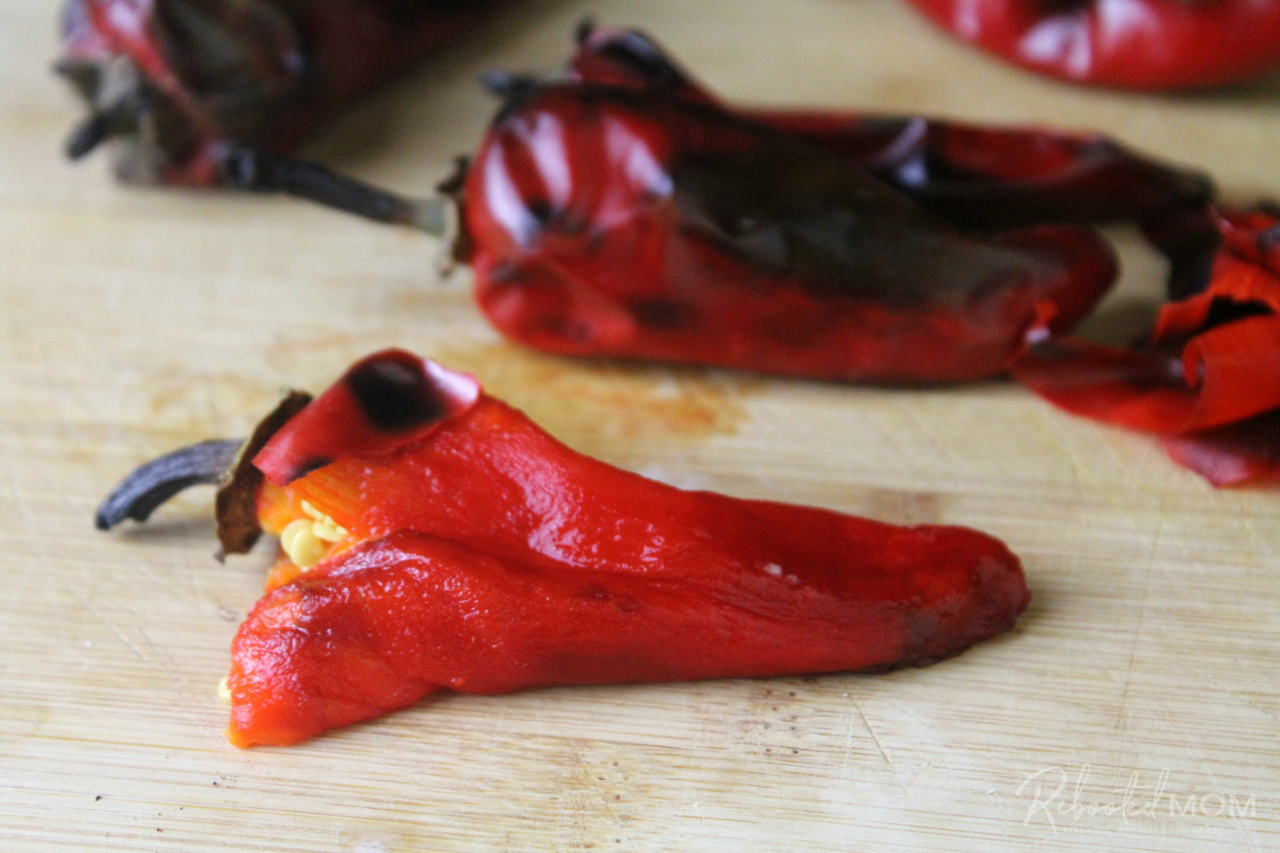 Roasted Fresno Peppers on a cutting board