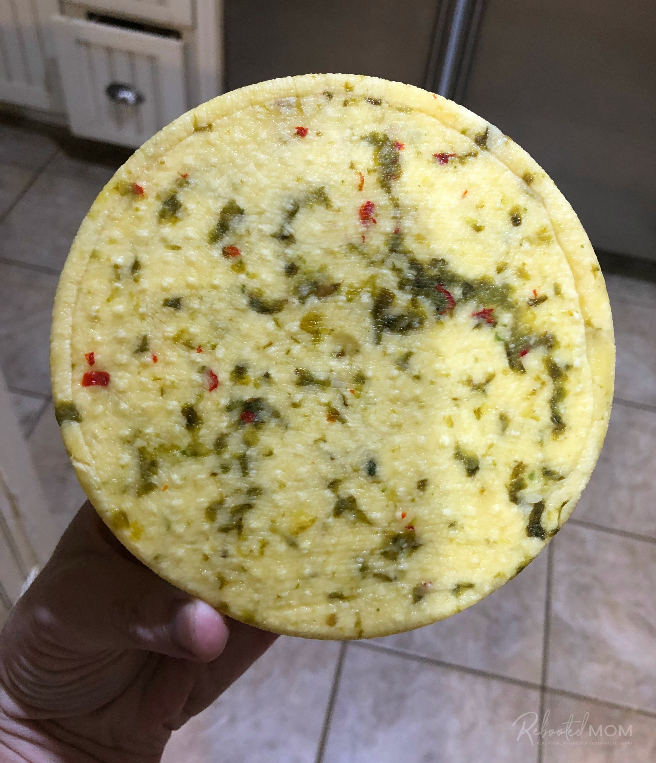 Hatch chile cheddar cheese after pressing at 50 lbs for 12 hours