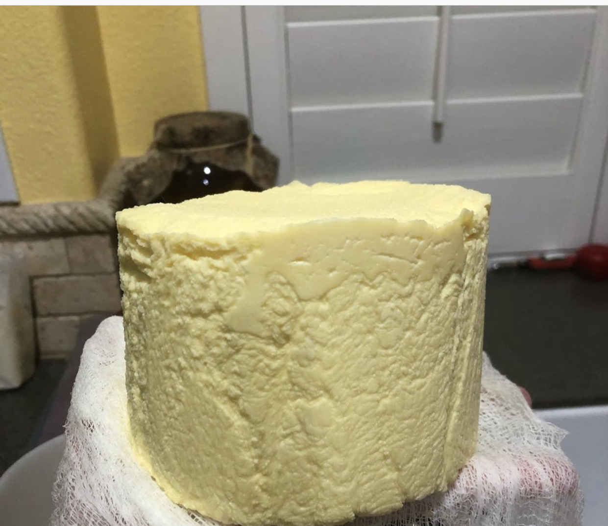 Unwrap and re-mold the cheese, press at 15 lbs for 12 hours