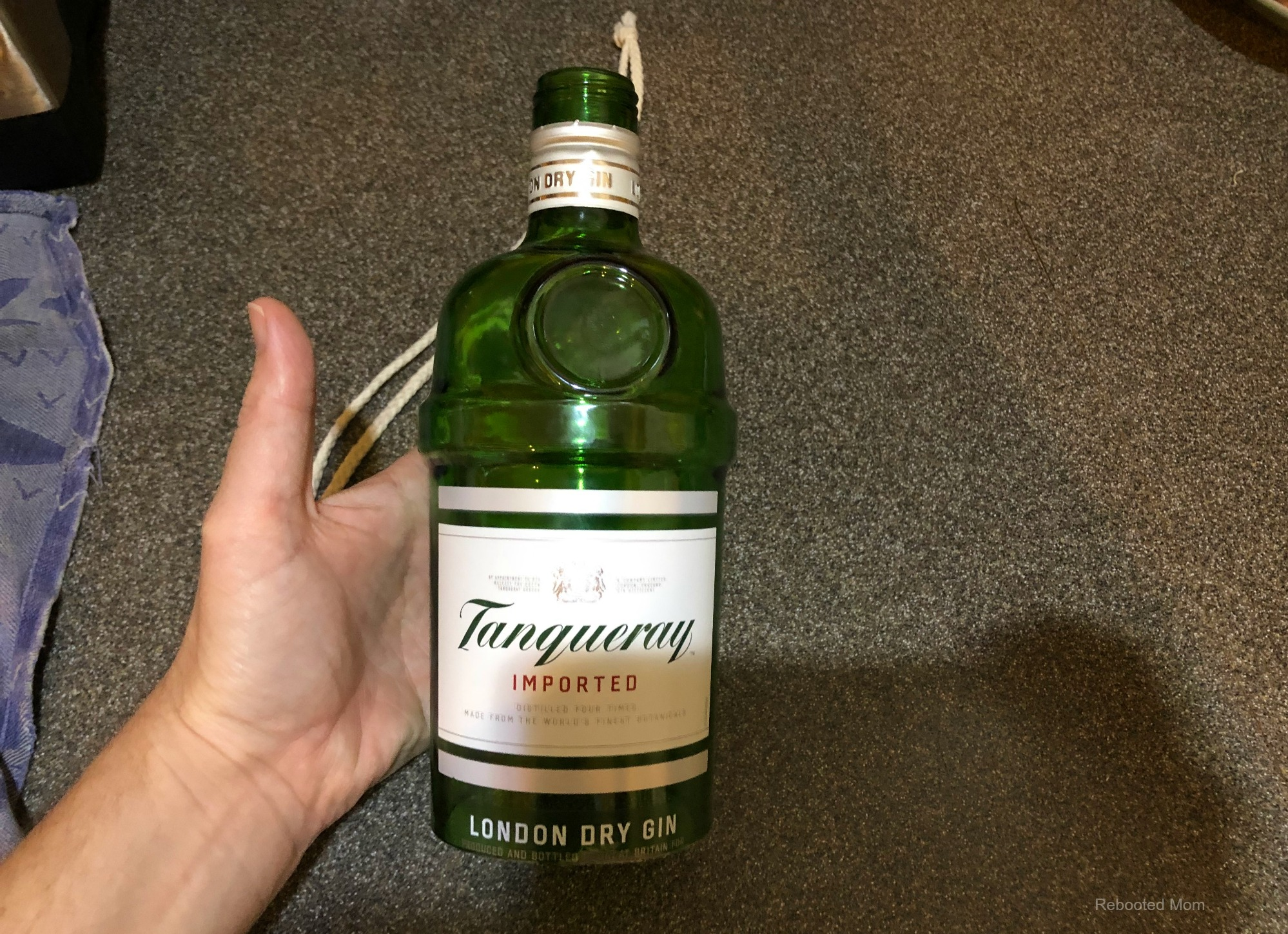Cutting a glass Gin bottle